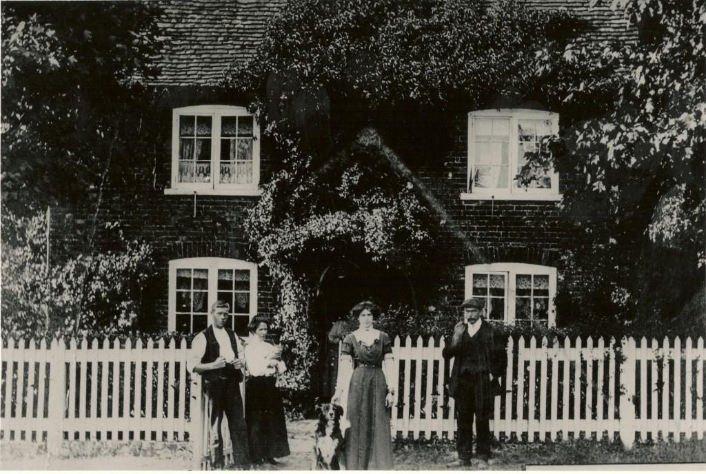 The Farm Bailiff and his family outside Hillplace Farm Wood Street Village
